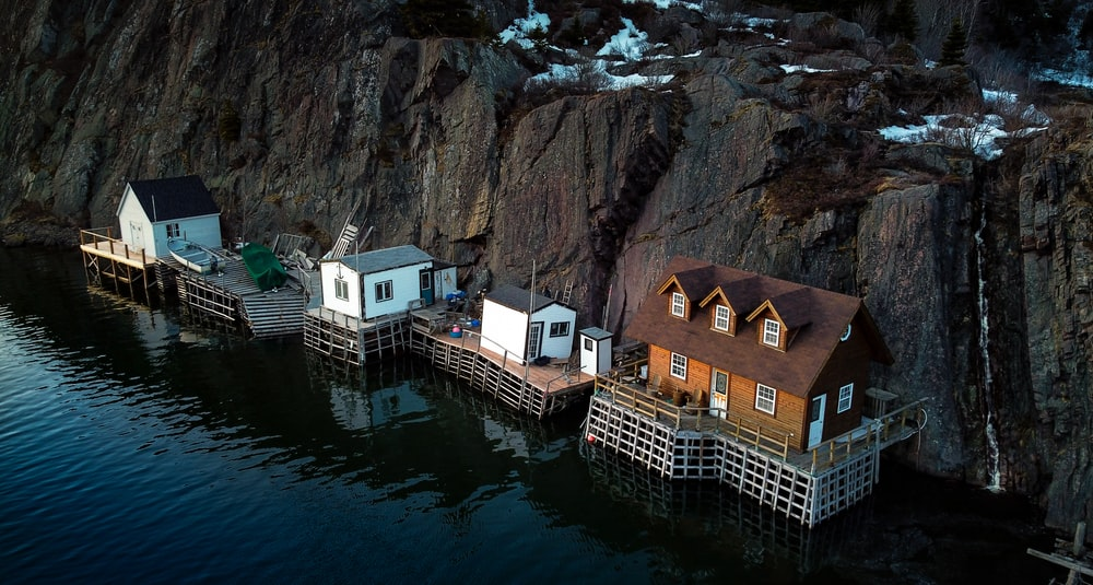 houses beside body of water during daytime