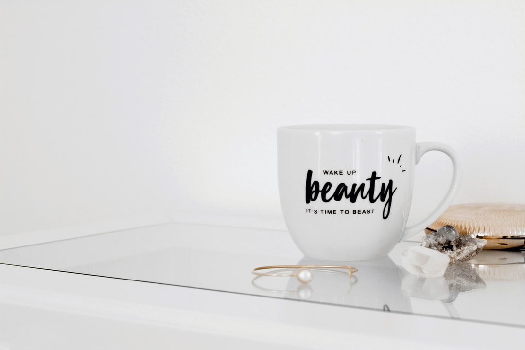Coffee Mug With Gold Decor and Crystals - unsplash