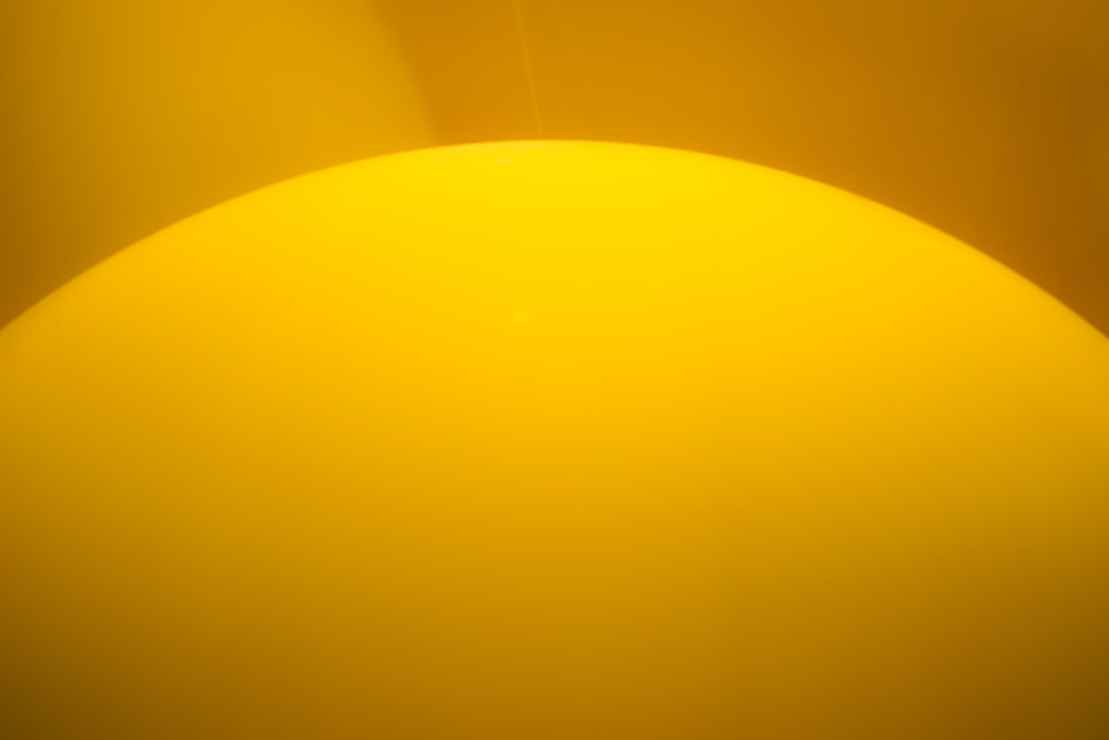 yellow round plastic on brown wooden table