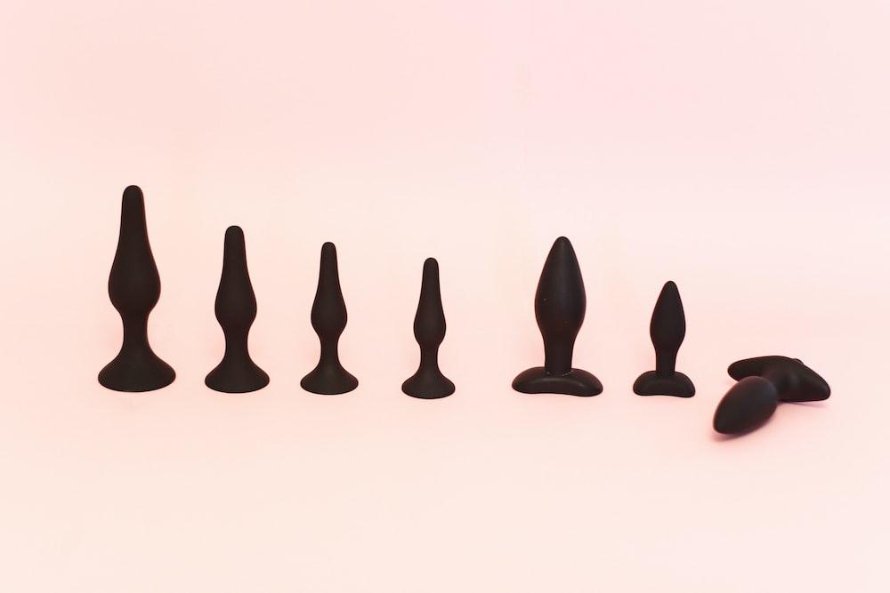 black human figure on white surface