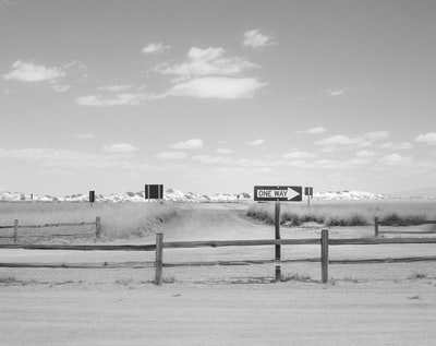 grayscale photo of a wooden fence with a distance at a snow covered field new mexico zoom background