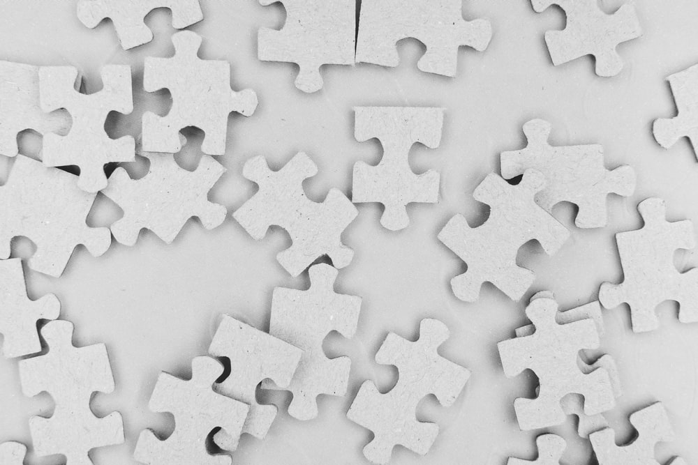 white and black jigsaw puzzle