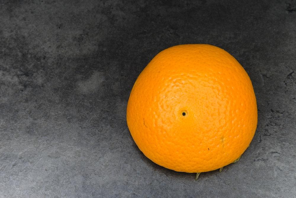 orange fruit on gray textile