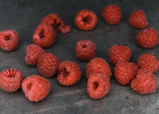 red round fruits on gray textile