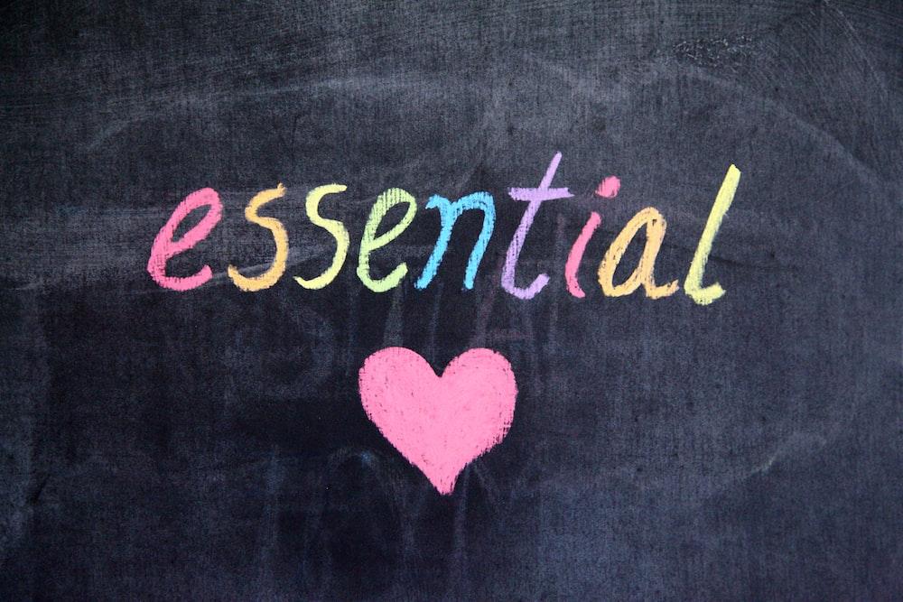 essential written on a chalkboard