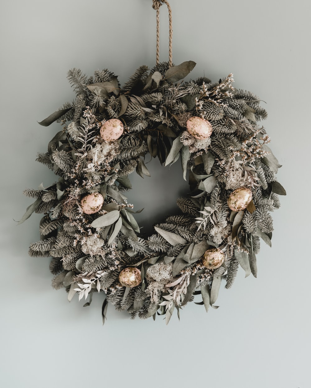 brown and white pine cone wreath