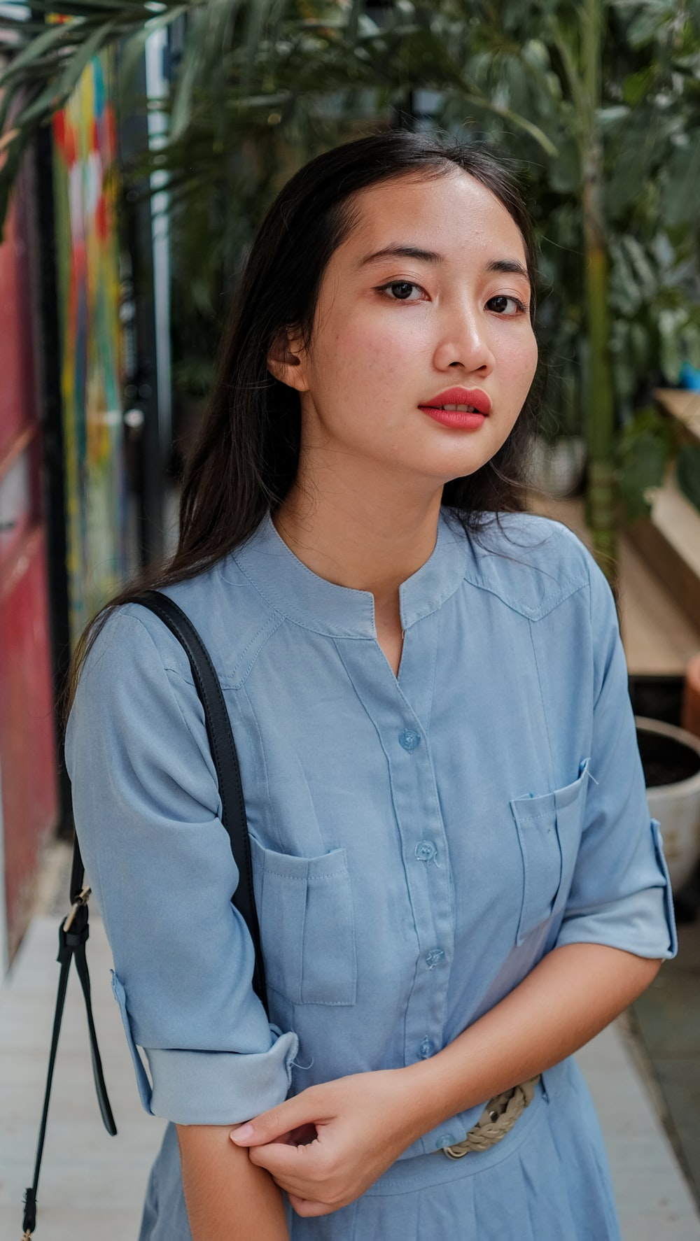 woman in blue button up shirt