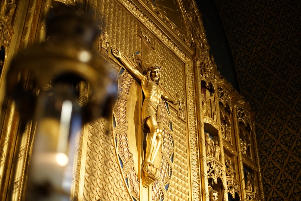 gold angel statue in a room