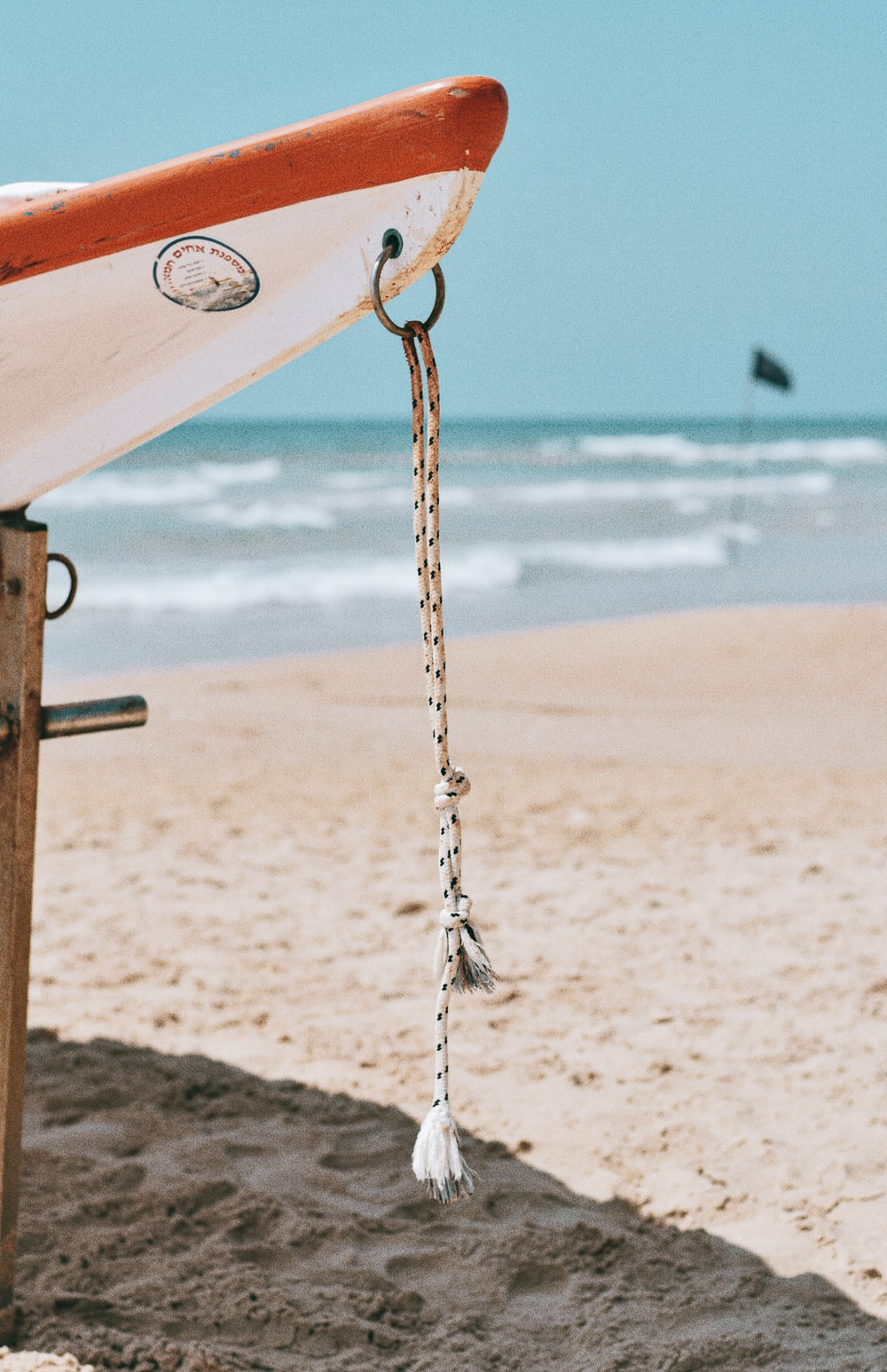 brown metal chain on beach during daytime