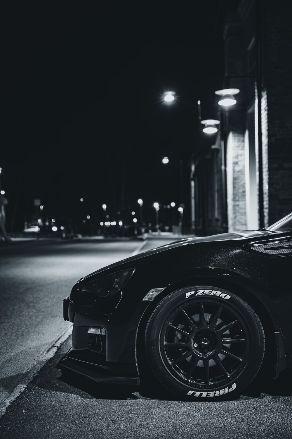 black car on road in grayscale photography