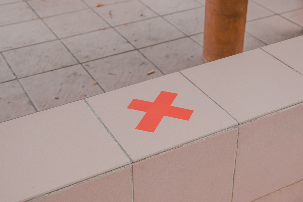 white box with red cross