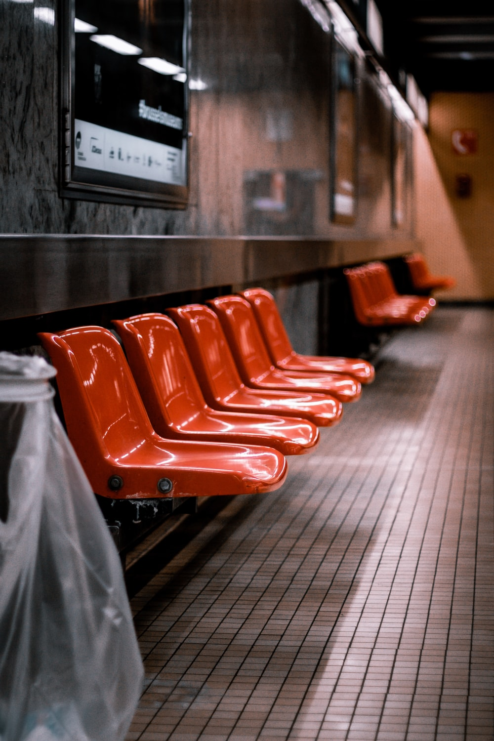 red plastic chairs on black floor
