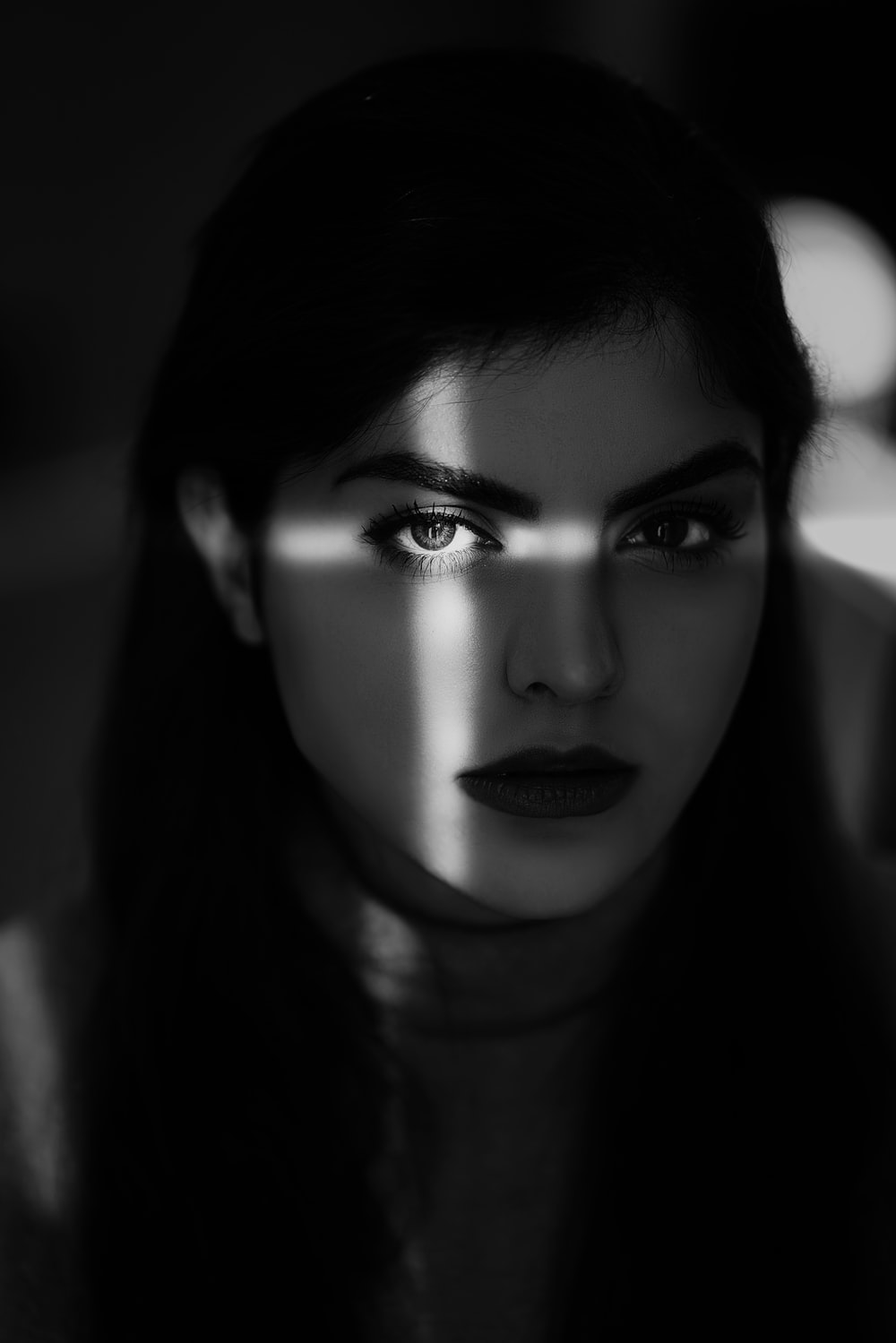 womans face in grayscale