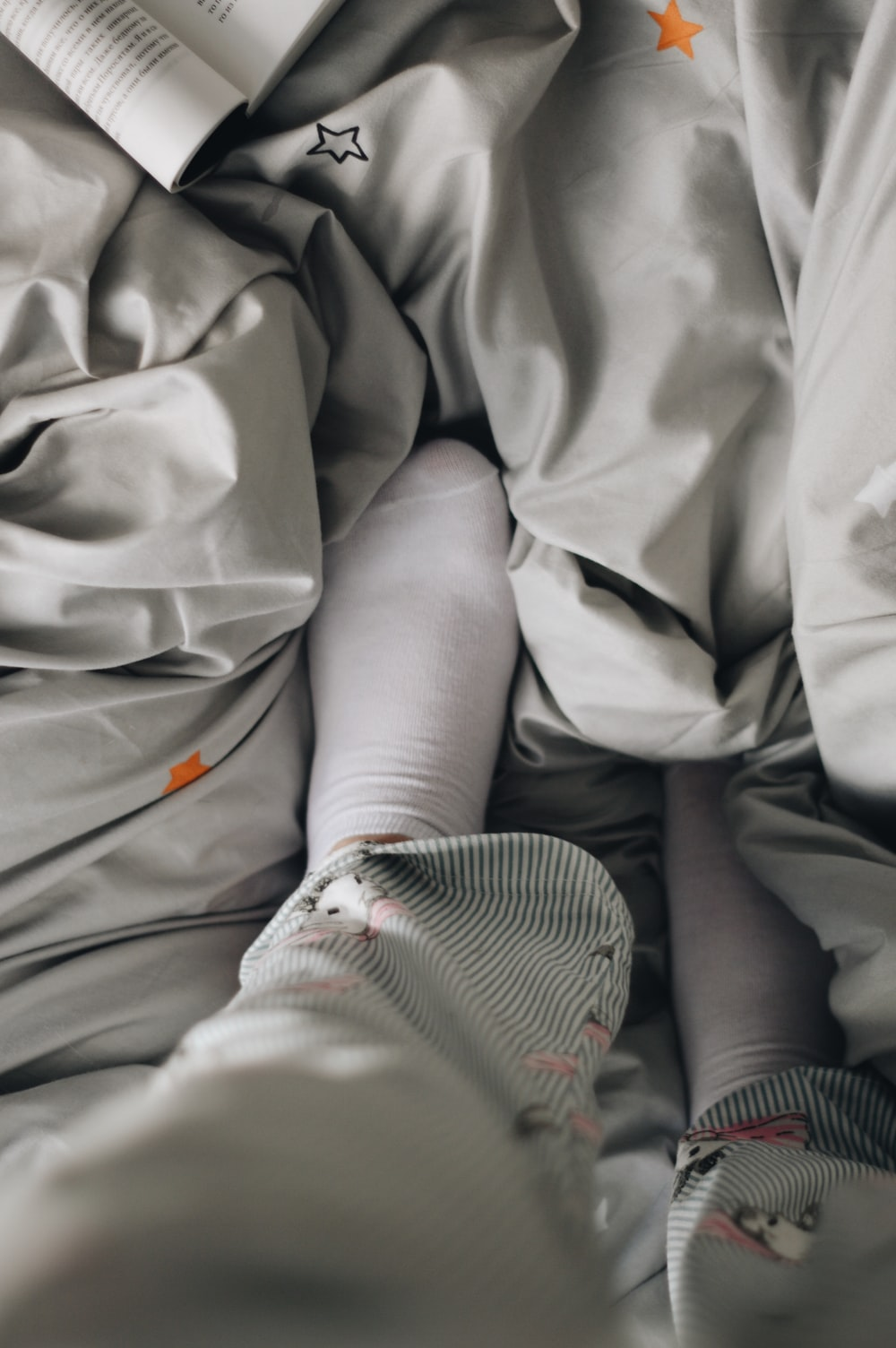person in gray pants and white socks