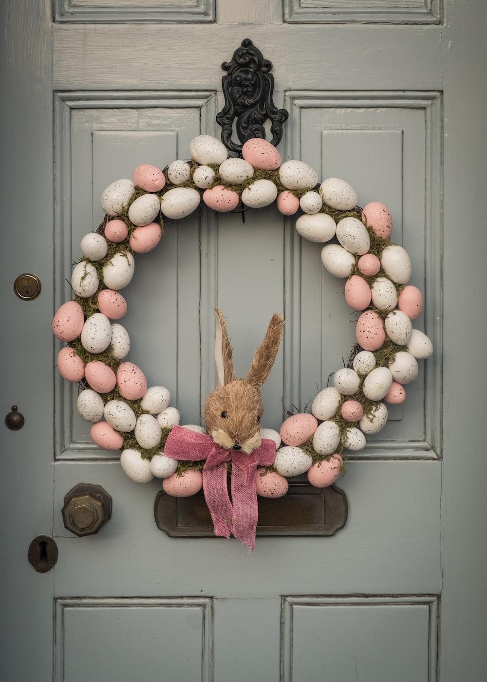 brown rabbit plush toy on gray wooden door