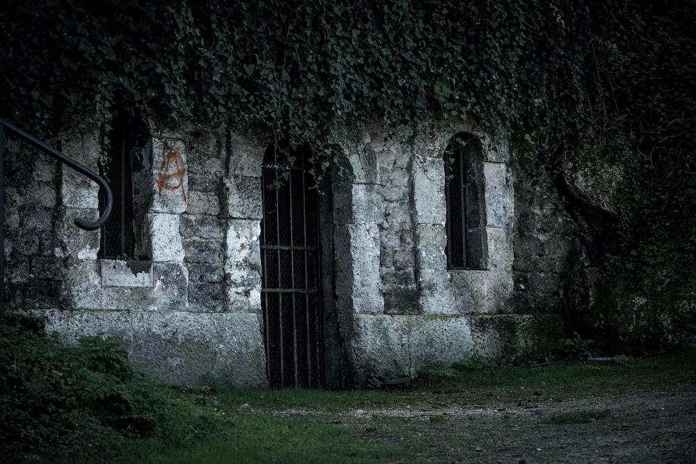 black metal door on gray concrete building
