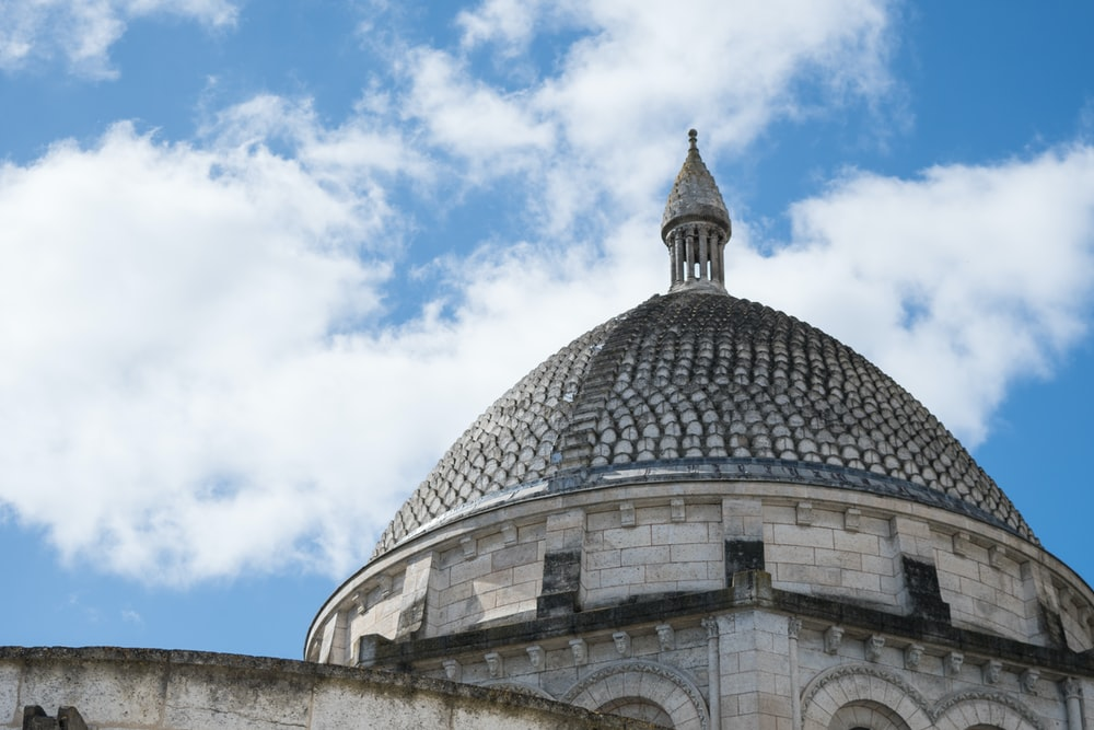 gray concrete dome building under blue sky during daytime