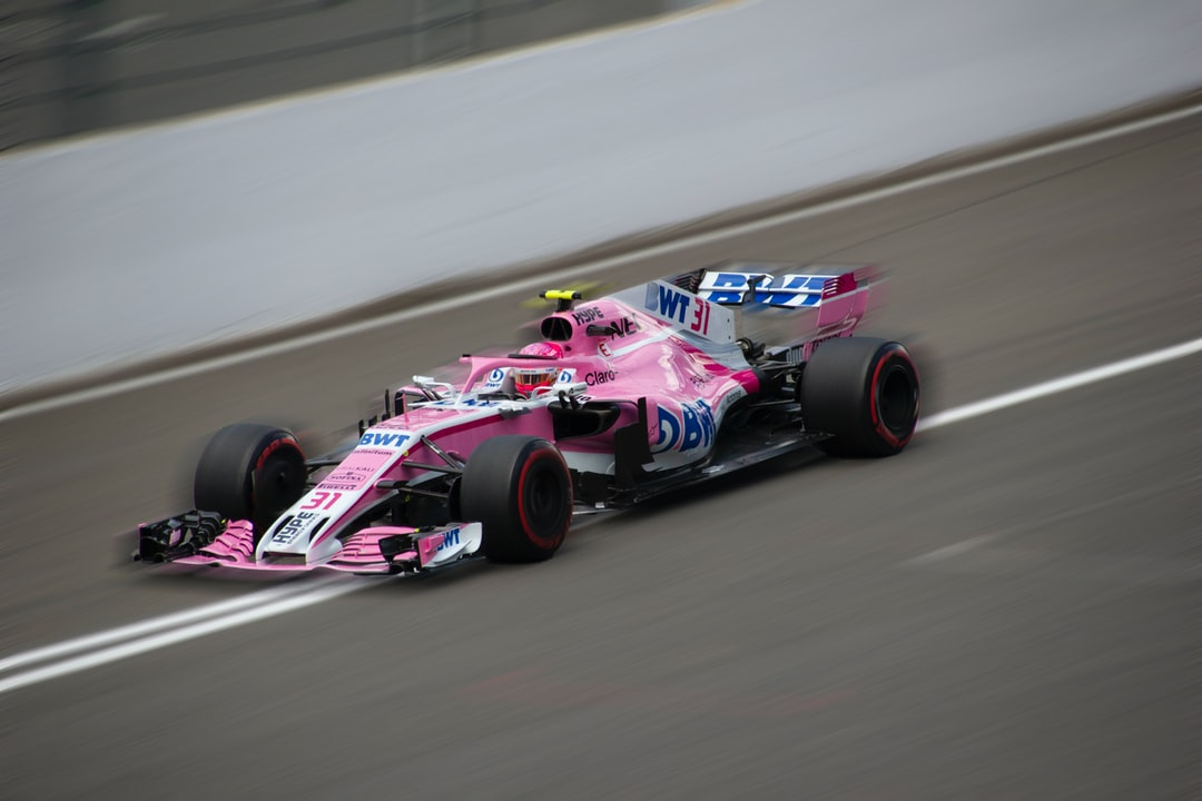 Esteban Ocon driving to Eau Rouge at Spa Francorchamps.