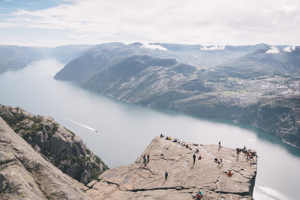 people standing on rocky mountain during daytime