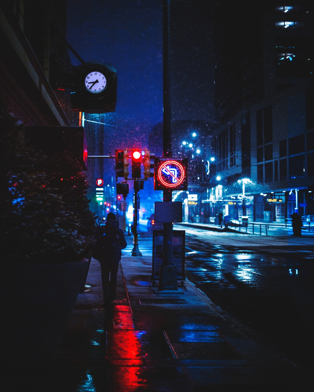 red and white traffic light on the street during night time