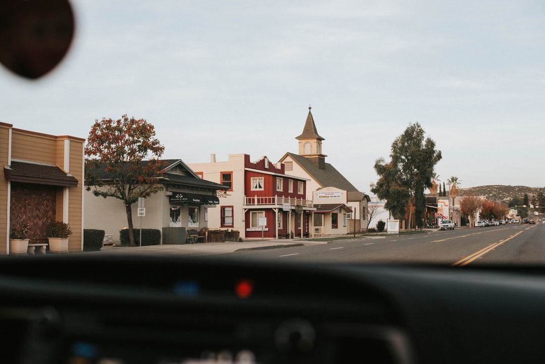 A quiet street scene with an old-fashioned church and other buildings in Ramona.