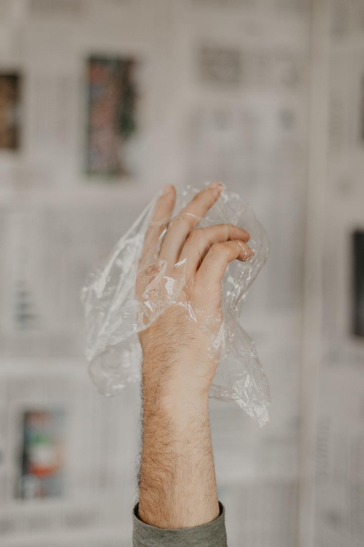person holding white plastic bag