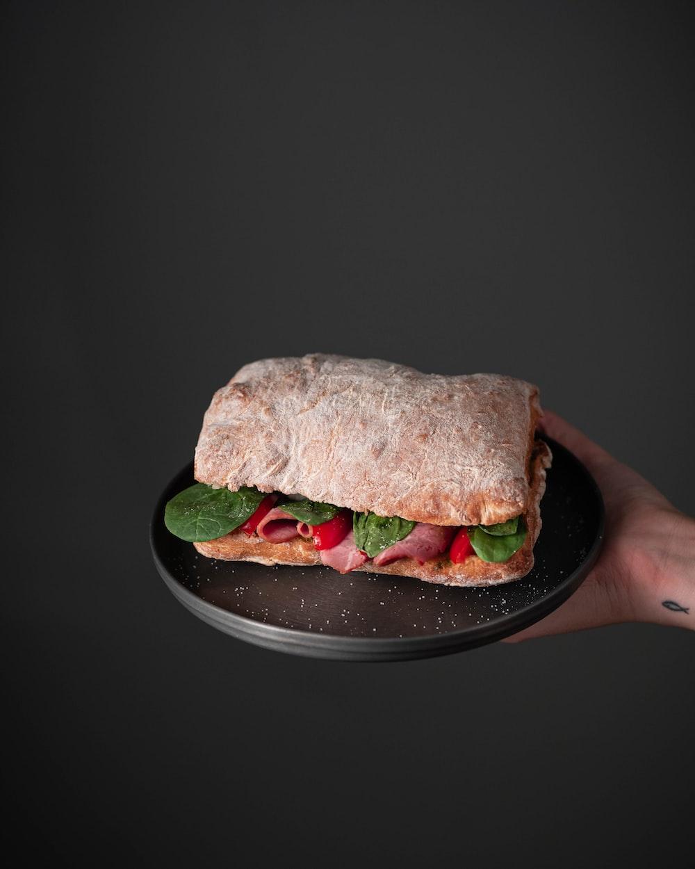 burger on black ceramic plate