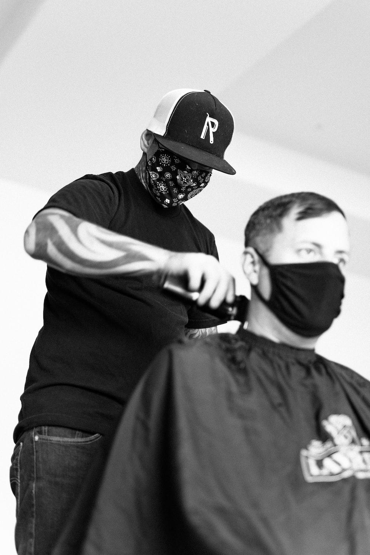 man in black long sleeve shirt and black helmet