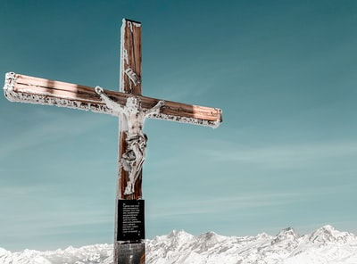 brown wooden cross on snow covered mountain under blue sky during daytime good friday zoom background