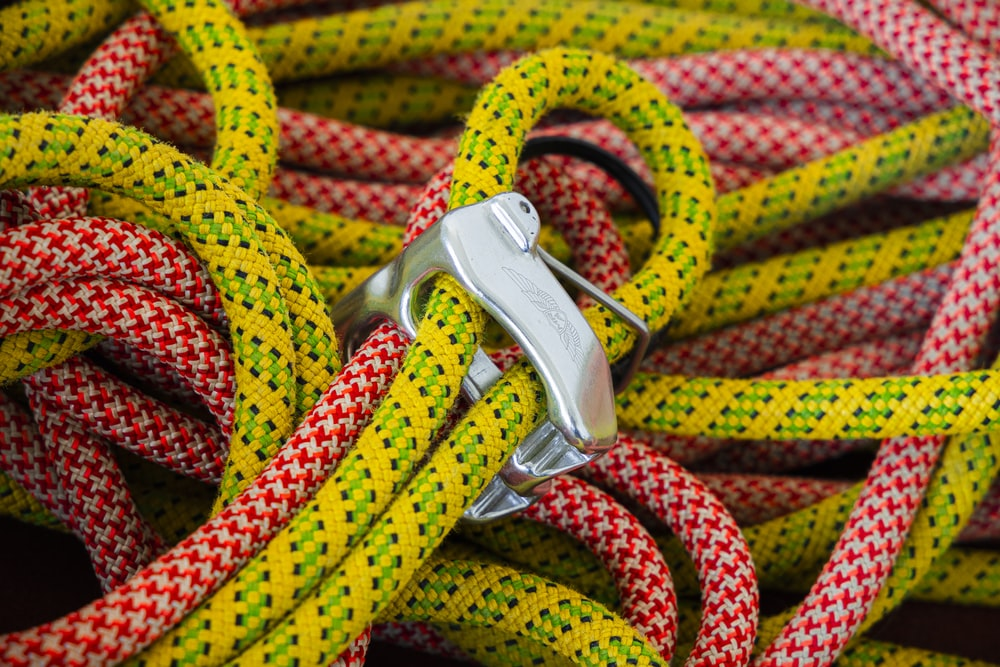 yellow and red rope on silver belt buckle