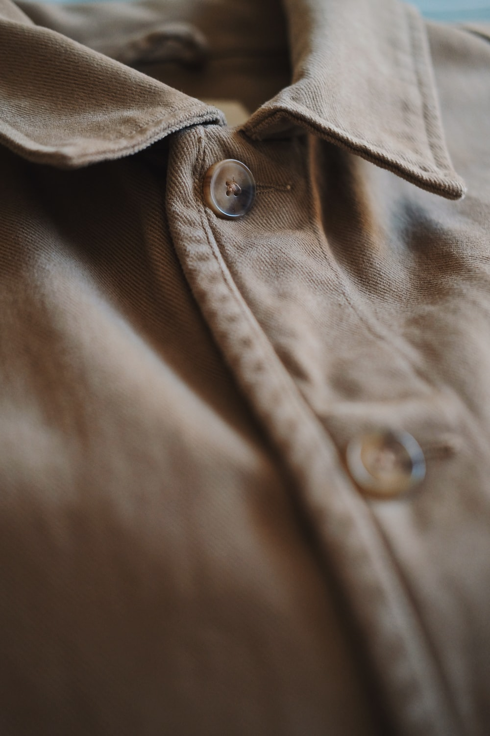 brown button up collared shirt