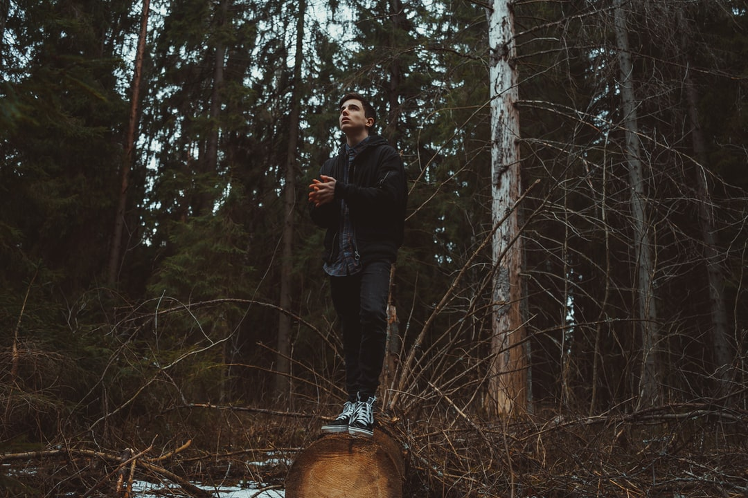 Young canadian guy in the middle of the forest