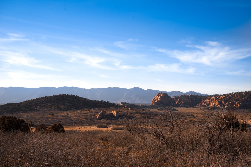 brown mountains under blue sky during daytime