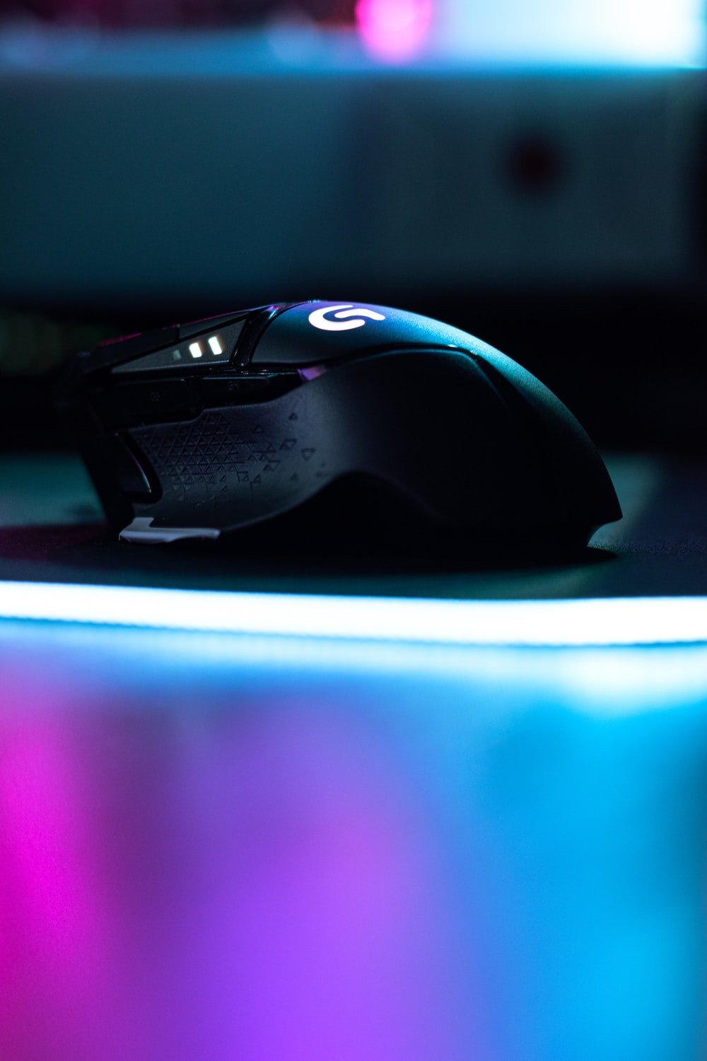 black and purple gaming mouse