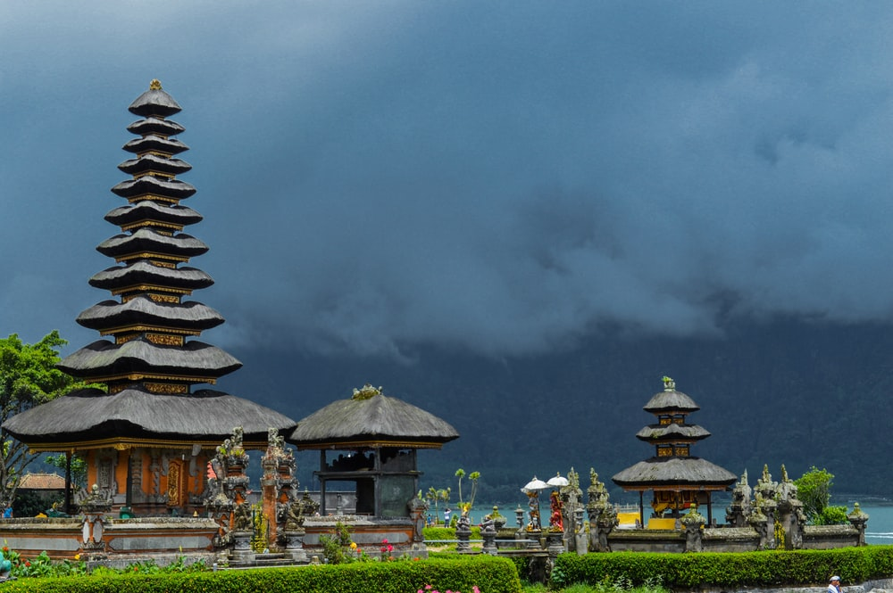 brown and white temple under gray clouds