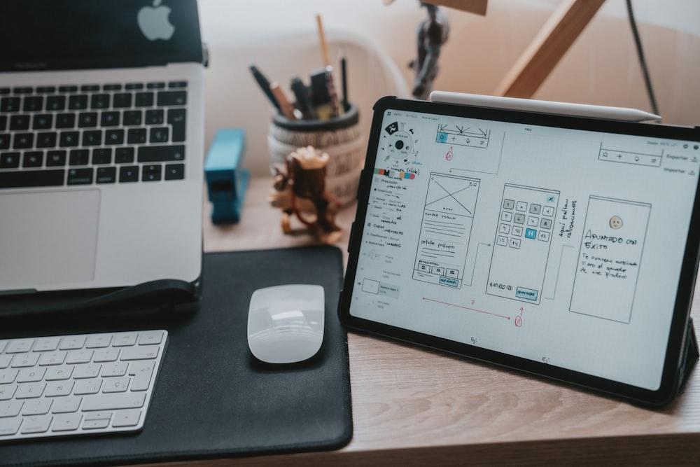 macbook pro beside apple magic mouse