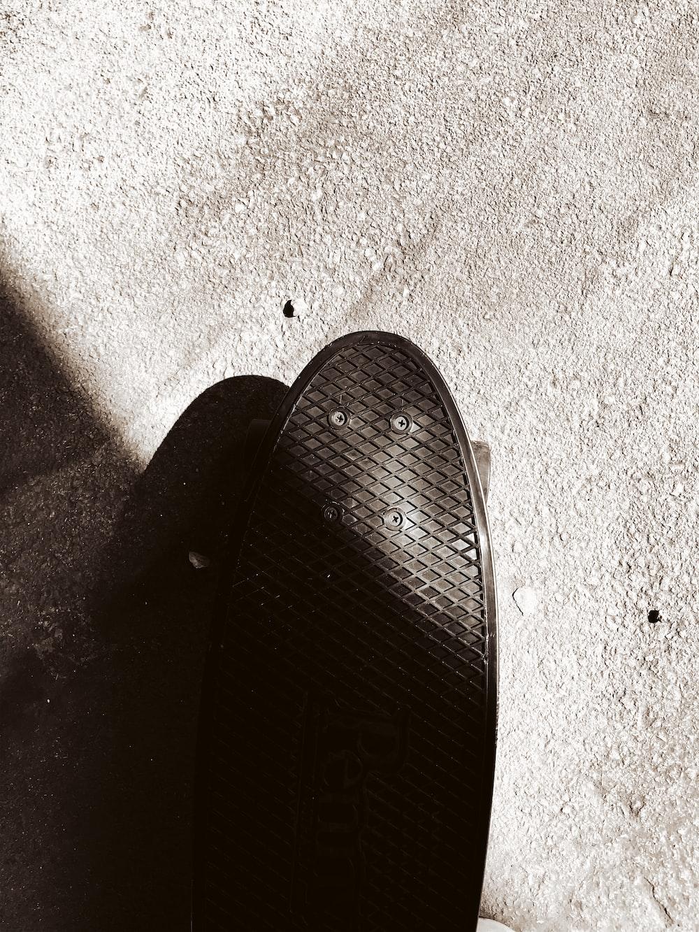 black flip flop on gray concrete floor