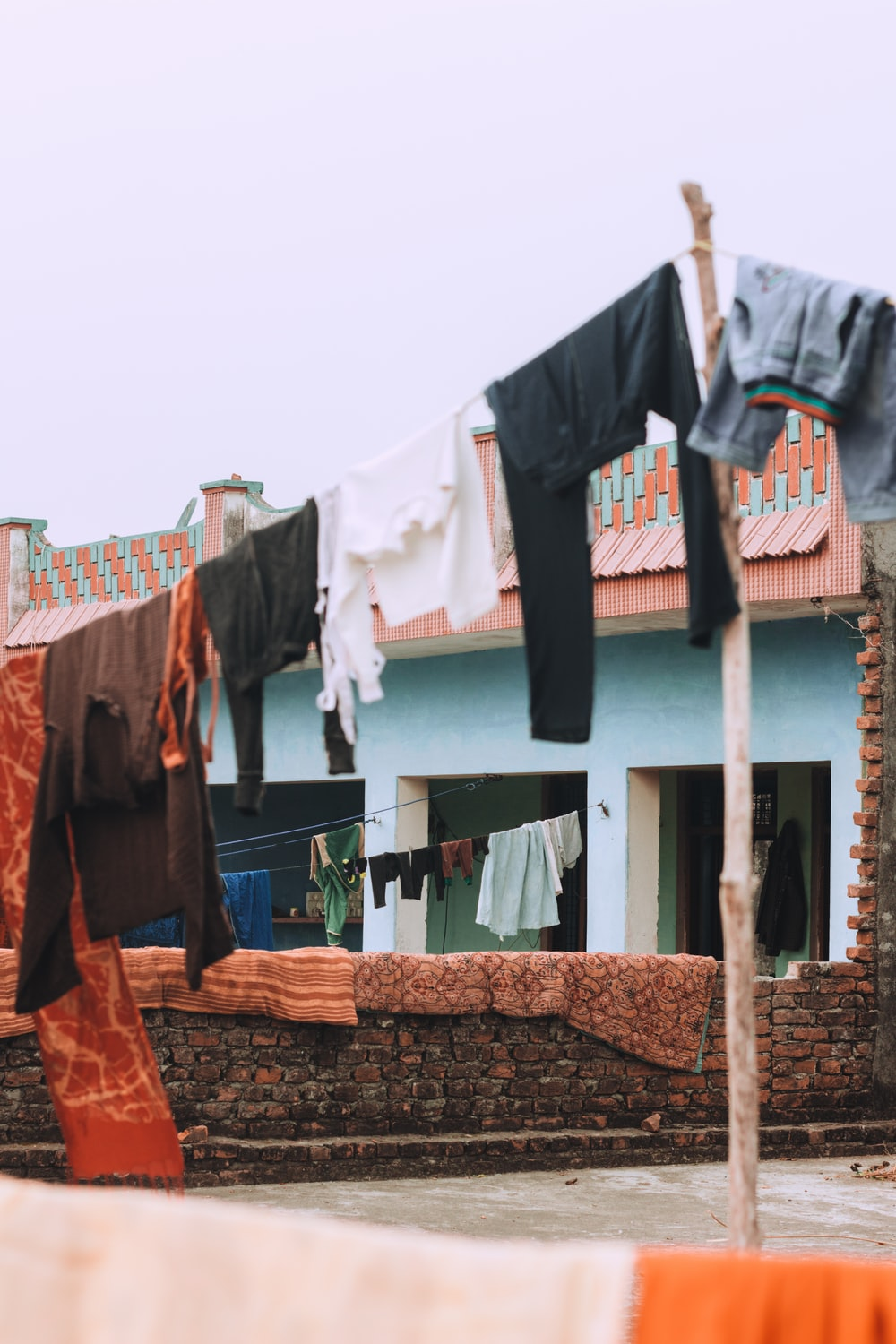 clothes hanged on string during daytime