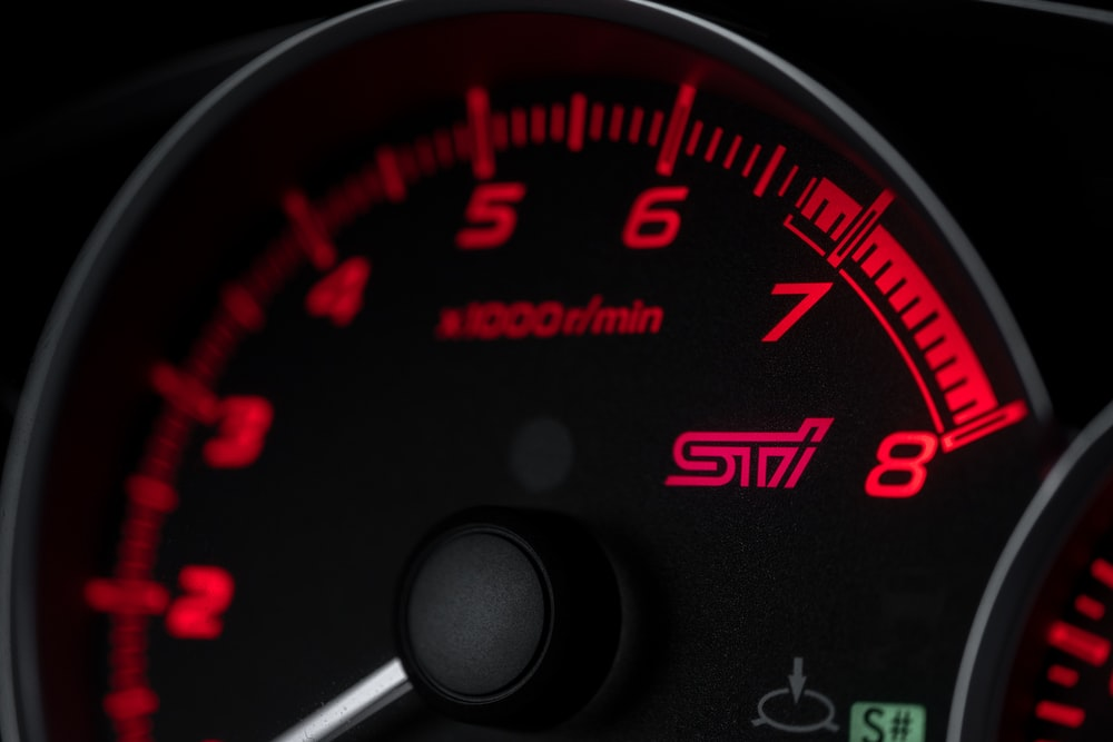 black and red speedometer at 0