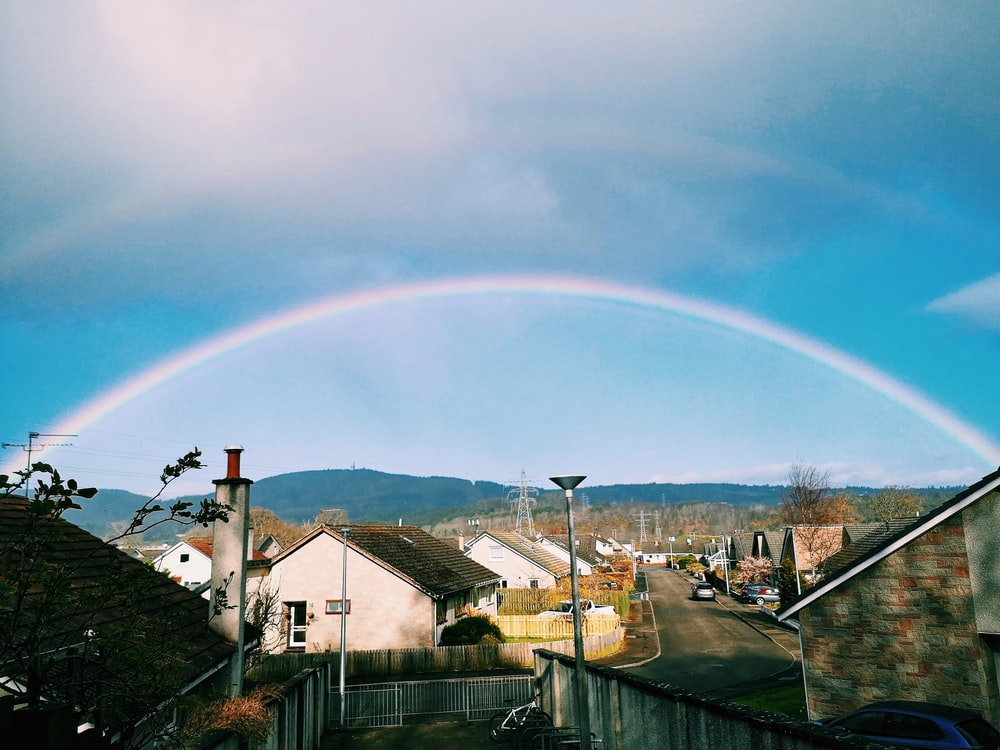 rainbow over houses and houses