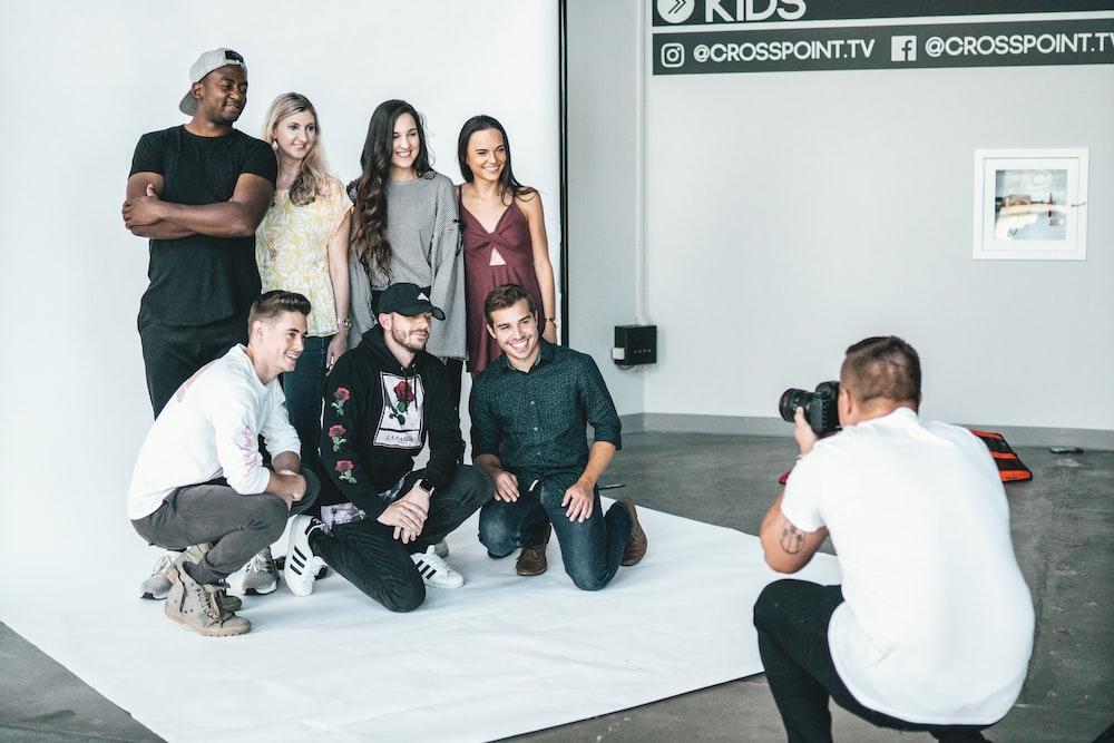 group of people sitting on white floor