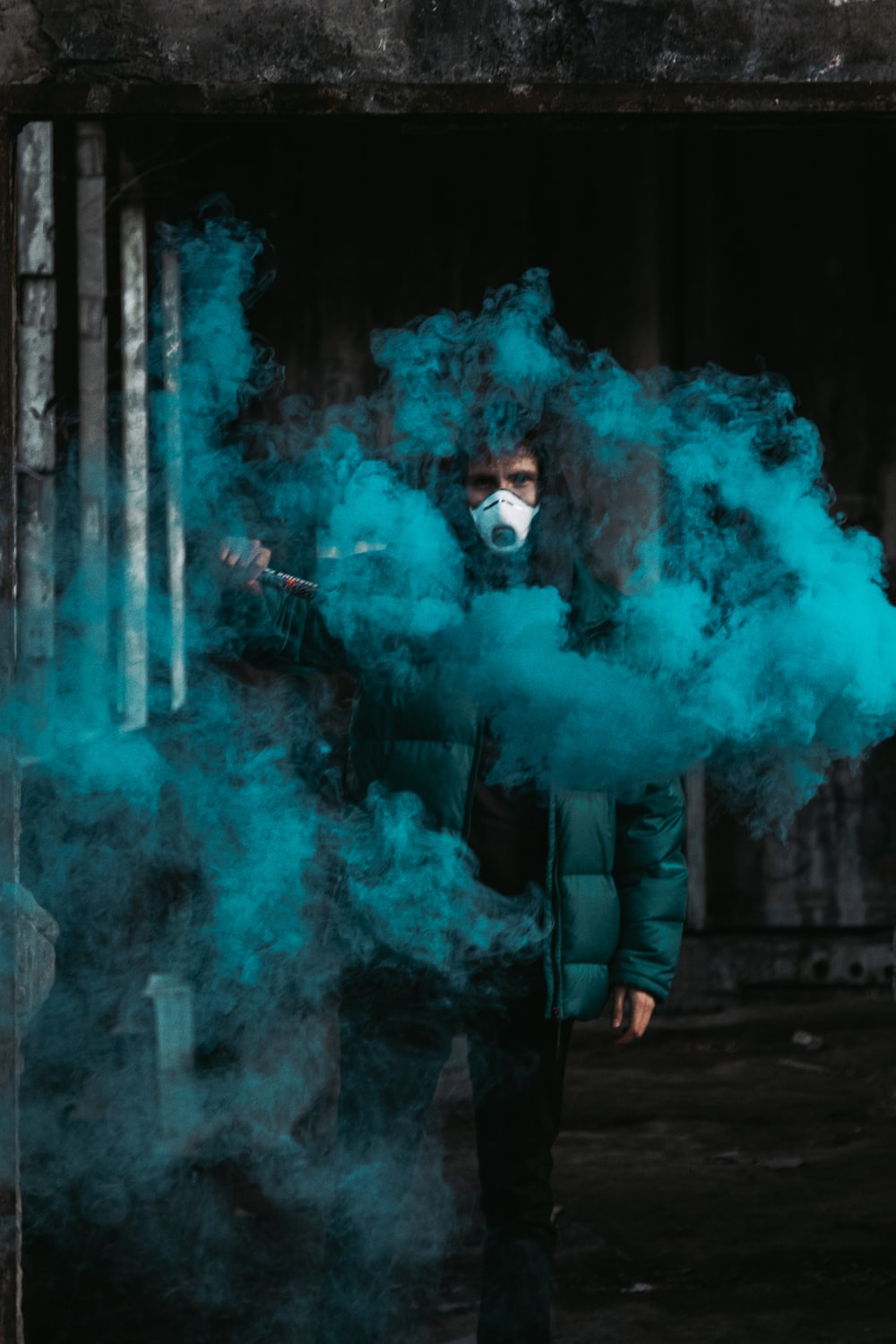 man in blue jacket with blue smoke
