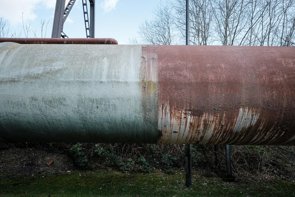 gray and brown metal tank