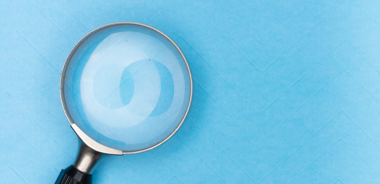 magnifying glass on white table