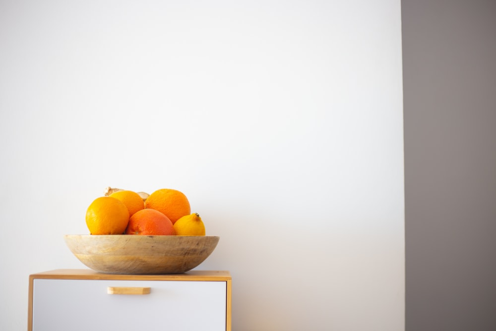 orange fruits on white wooden drawer