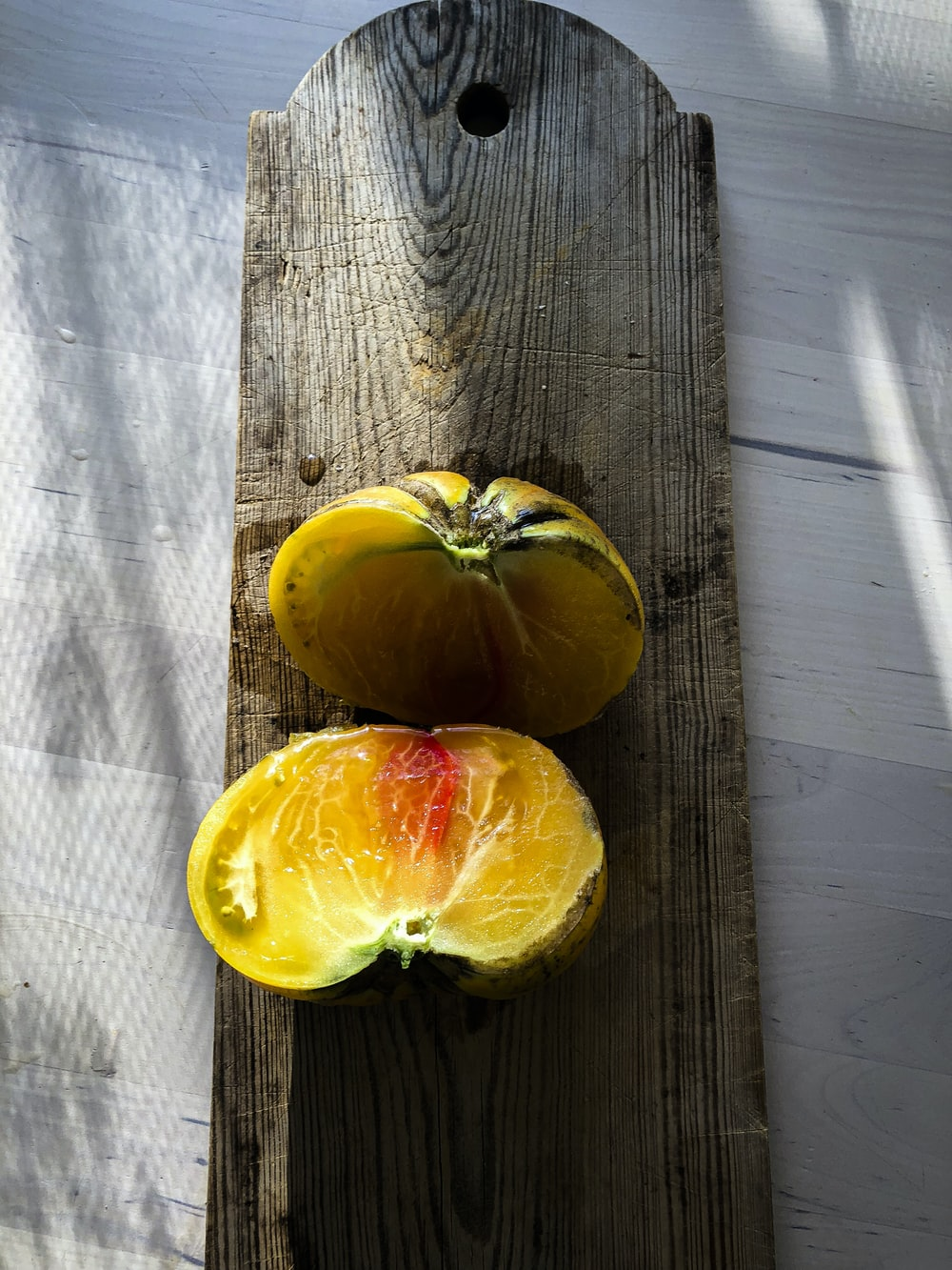 yellow fruit on brown wooden table