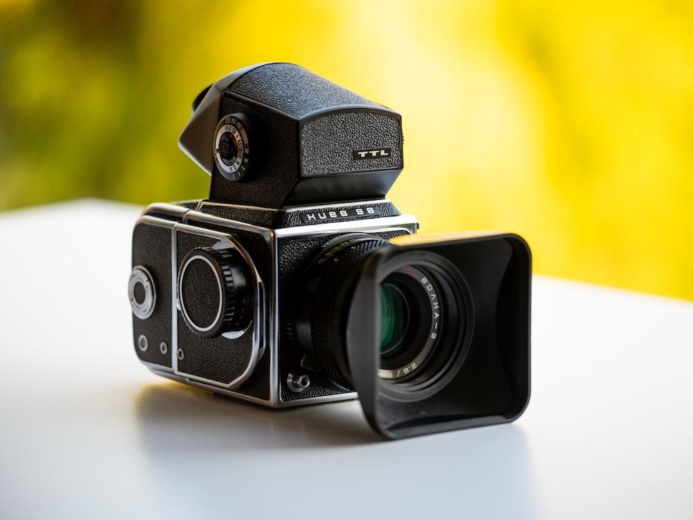 black and silver dslr camera