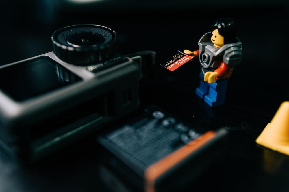 lego mini figure on black surface