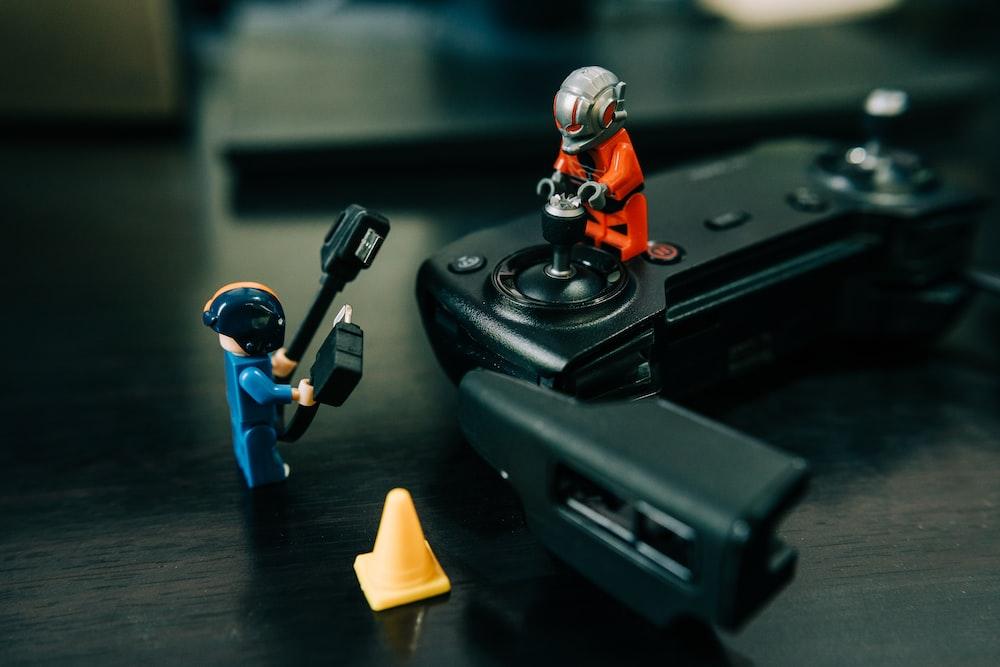 lego minifig on black device