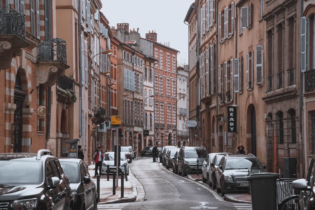 Narrow street in Toulouse France with pink-red buildings
